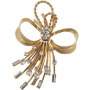 Signed Sarah Coventry gold tone Brooch with crystal rhinestones in a floral spray