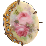 Small vintage hand painted porcelain Brooch in a floral design gilded with tiny turquoise colored enamel beads