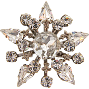 Small vintage snowflake brooch with crystal rhinestones