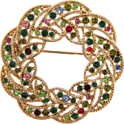 Vintage circular Brooch in a wreath design with multicolored rhinestones