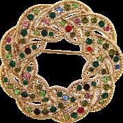 Vintage circular Brooch in a wreath design with multicolored rhinestones