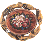 Vintage floral mosaic set in goldstone Brooch with floral frame