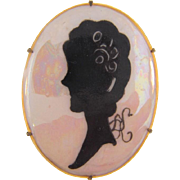 Early oval porcelain hand painted Brooch of a silhouette