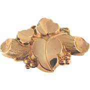 Lovely early gold filled Brooch in a grape vine design