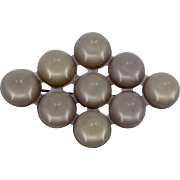 1920s Celluloid Domes or Cones Array Pin Mauve & Clear