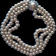 Vintage 1960s Baroque Faux Pearls Triple Strand Necklace Big Rhinestone Clasp