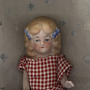 Antique All Bisque German Girl with Molded Blue Hair Bows