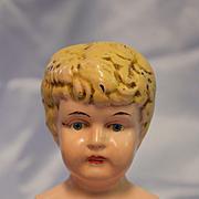Antique Metal Doll Head