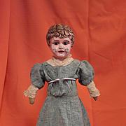 Antique Brass Head Doll in an Antique Wool Dress