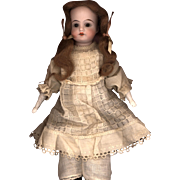 Antique German Bisque Doll in Antique Clothing