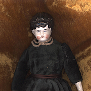 Antique China Head Doll with a Turned Head