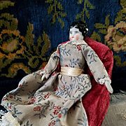Antique China Head in Antique Clothing