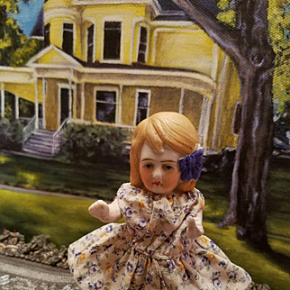 Antique All Bisque Girl with Molded Bow