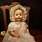 Early Hard Plastic Baby in Original Clothes