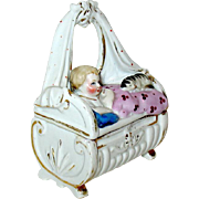 Gorgeous Antique Conte and Boehme Victorian Baby w Cat Fairing Box