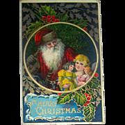 Glossy Gilt Decorated Christmas Postcard, Santa Claus, Girl and Dolls