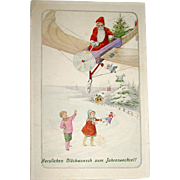 German Santa Claus in Primitive Airplane, Hand Colored Postcard