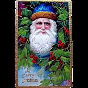 Youthful German Santa Claus Wearing Blue Hat Christmas Postcard