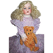 "Lovely 21"" Nippon Bisque Head Doll Dressed in a Pretty Lilac Colored Outfit"