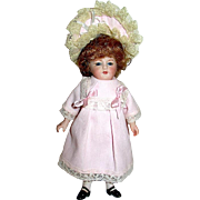 Vintage 7 inch All Bisque Doll, Pretty Dress and Wire Rim Parisian Hat