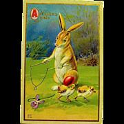 Nash Easter Postcard—Fantasy Bunny Drops Egg on Baby Chick's Head