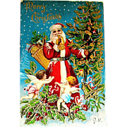 First Version of Santa Claus & Cherubs Scene Christmas Postcard - Heavy Gilt