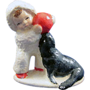 Cast Iron Snowbaby and Seal Paperweight