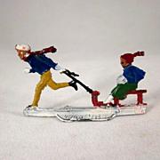 Germany Lead Flat Kid Pulls a Kid on a Sled Winter Figure