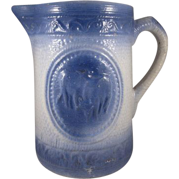 Blue and White Stoneware 'Grazing Cows' Pitcher