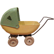 "Wyandotte Larger Size Steel Doll Buggy 8"" Yellow and Green"