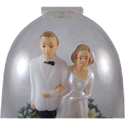 Hard Plastic Bride & Groom in Bell Cake Topper