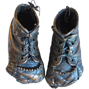 Pair of Bronzed Baby Shoes with Fringe and Holes