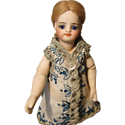 """5"""" All-Bisque W / Jointed Elbows And Original Poupee Modele Dress - 1880 - Attributed to S&H"""