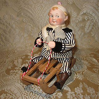Bisque Head Boy on Sled Candy Container - Likely Heubach