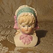 German Bisque Doll Head - Molded Bonnet