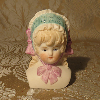 German Bisque Doll Head - Molded Bonnet