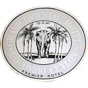A Vintage Suitcase Sticker for The Grand Oriental Hotel - Colombo, Ceylon