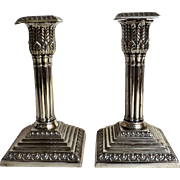 A Pair Of Victorian Sheffield Plate Candle Sticks