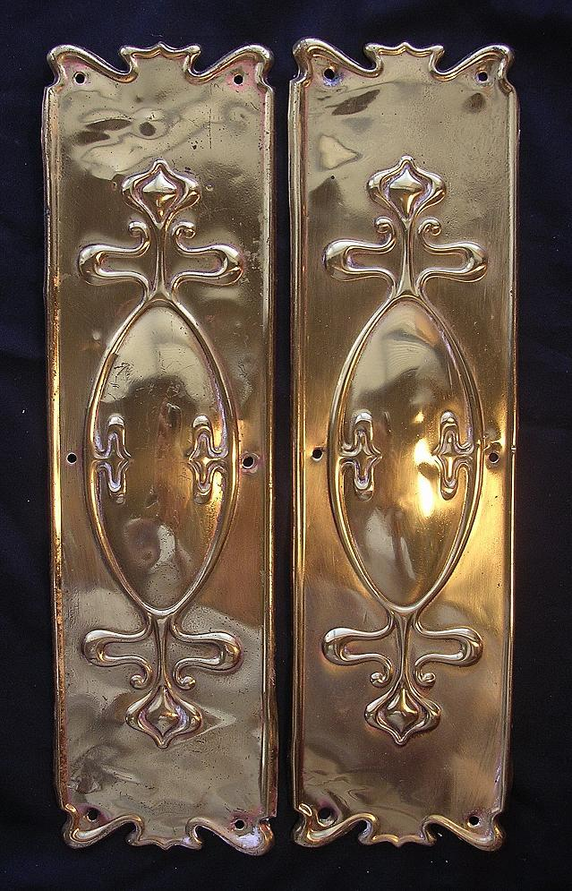 a pair of victorian art nouveau door brass finger plates