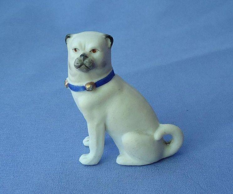 vintage bisque sitting PUG with  blue bell collar 2""
