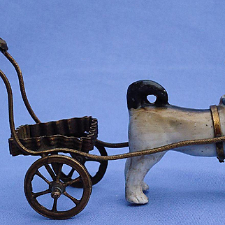 PUG pulling brass cart