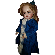 "French Bisque Blue-Eyed Bebe ""Mascotte"" by May Freres"