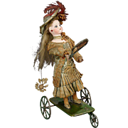 "French Mechanical Toy ""Little Girl Playing Badminton"" by Vichy"