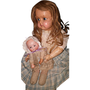 Seldom Seen Celluloid JDK Girl with baby