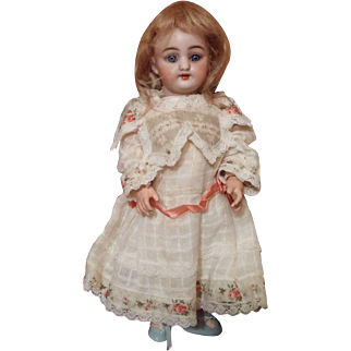 German Bisque Pretty Petite Simon Halbig Doll with trunk and Trousseau