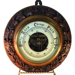 English Barometer in Carved Black Forest Frame