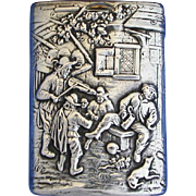 Fiddler playing in yard scene, slide type match safe, 830 silver