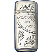 Sterling match safe with engraved designs, by Dominick & Haff, 1882