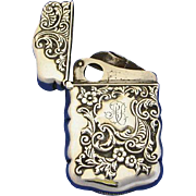 Floral motif match safe w/ cigar cutter, sterling by Hayden Mfg. Co., Patent March 21, 1892