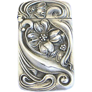 Floral motif match safe by Unger Bros., sterling
